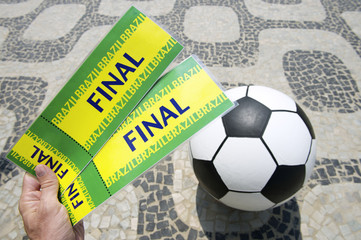 Soccer Fan Holds Tickets to Football World Cup Final in Brazil