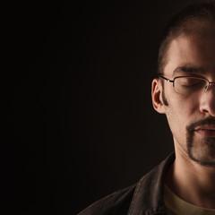 Man in Meditation on black background
