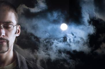 Dreaming man, night sky full moon background.