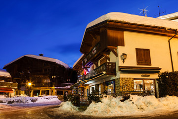 Fotomurales - Illuminated Street of Megeve on Christmas Eve, French Alps, Fran
