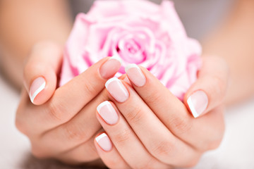 Poster de jardin Manicure Beautiful woman's nails with french manicure and rose