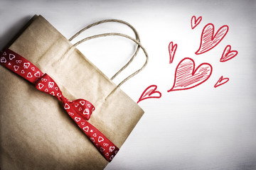 Valentine's gift bag with red ribbon