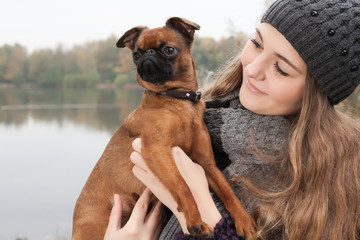 Winter teenager and her dog