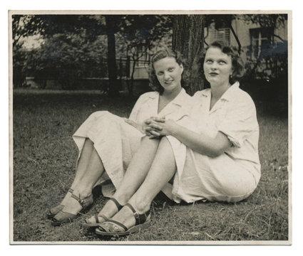 Two nurses on the lawn - circa 1950