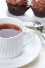 Drink tea with cupcakes