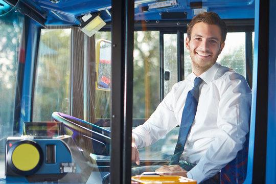 Portrait Of Bus Driver Behind Wheel