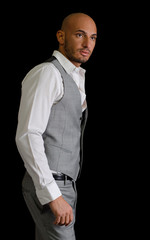 Bald, handsome young man with elegant shirt and vest