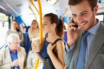 Passengers Standing On Busy Commuter Bus Wall mural