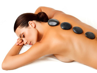 Wall Mural - Stone Massage. Beautiful Woman Getting Spa Hot Stones Massage