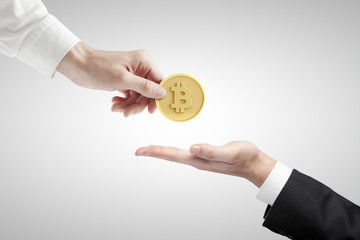 hand giving bitcoin