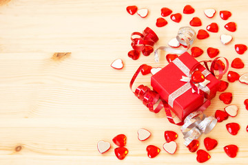 red gift box, ribbons, valentine's hearts