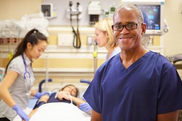 Portrait Of Male Nurse Working In Emergency Room