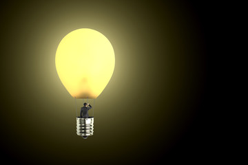 Man taking glowing lamp balloon looking at distant place