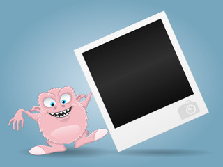 Funny monster and photo frame.