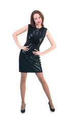 Middle age woman in a little black dress on white background