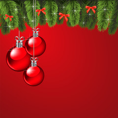 Christmas background with a red ball and Christmas tree branch