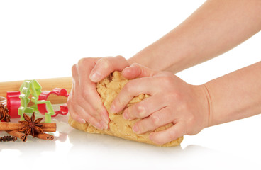 Hands knead the dough for Christmas cookies