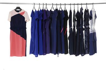 female fashion sundress clothing on hangers at the show