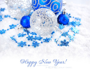 Christmas blue and silver decorations on snow