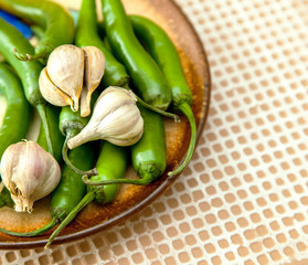green chili peppers and garlic cloves