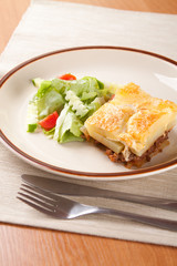 Front ground beef meat with tomato and cream