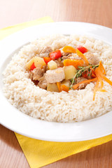 Pork with vegetables, garlic and rice