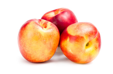 Close up of three peaches, isolated