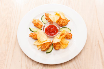 chicken croquette with chips and sauce