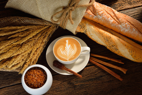 A cup of cafe latte and bread.