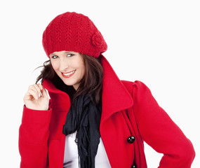 Young Woman in Red Coat and Cap Smiling