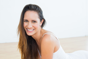 Portrait of a fit cheerful woman in fitness studio