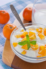 cream cottage cheese with sliced persimmons