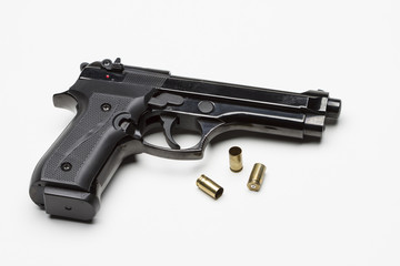 Handgun with bullets, horizontal