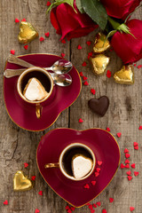 Cup of coffee in the form of hearts with roses. Valentine's Day