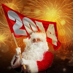 New year coming by Santa Claus. Santa with 2014 flag in firework
