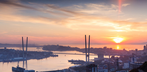 Vladivostok cityscape, sunset. With lens flare effect.