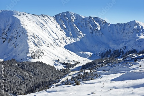 Wall mural Snow Mountain Peaks