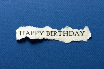 Happy birthday on scrap of paper