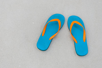 Top view slipper on sand on paradise beach