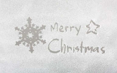 "Snow on the frozen window with word "" Merry Christmas "" and snow"
