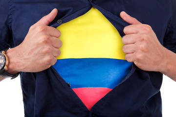 Young sport fan opening his shirt and showing the flag his count