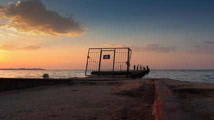 old soviet pier on sunrise