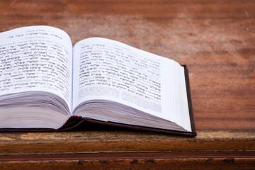 Jewish praying book on table.