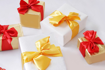 Gift boxes with golden and red ribbon