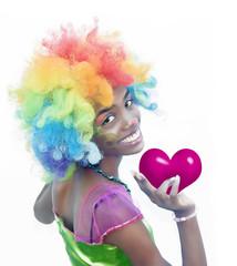 Happy Female Clown Holding a Heart