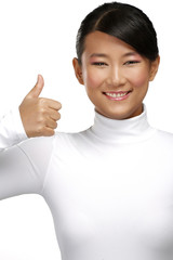 Beautiful happy asian girl showing thumbs up