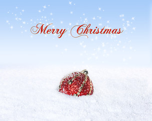 Christmas Greeting Card. Lonely Ball in the Snow