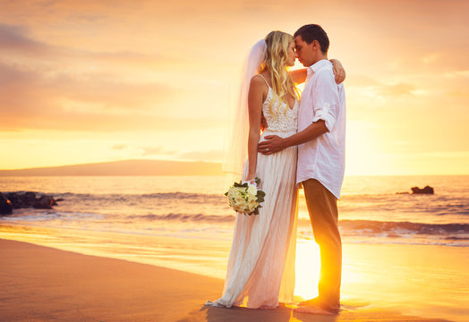 Bride and Groom, Kissing at Sunset on a Beautiful Tropical Beach