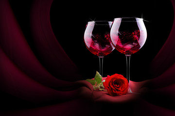 glass of wine with red silk and flower