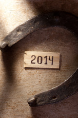 tags with 2014 on a wooden surface, horseshoe